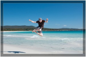 Skinny Backpacker - Jumping at Binalong Bay in Tasmania
