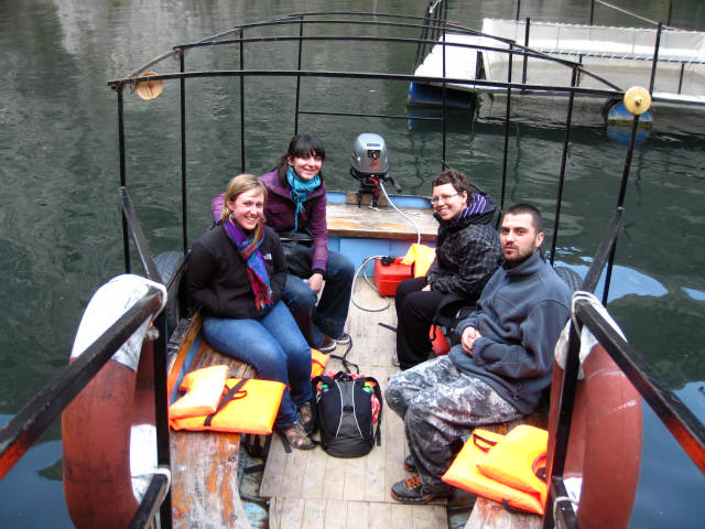 Me with my CouchSurfing hosts on a boat to see underwater caves in Lake Matka, Macedonia.