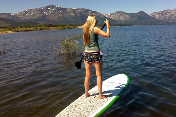 Amy stand-up paddleboarding on the beautiful Lake Tahoe