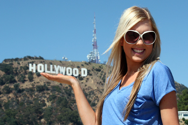 Amy holding the Hollywood Sign.
