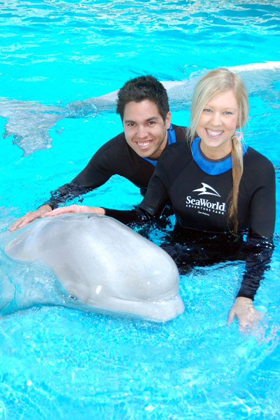 Kieron and Amy with Oliver the Beluga Whale