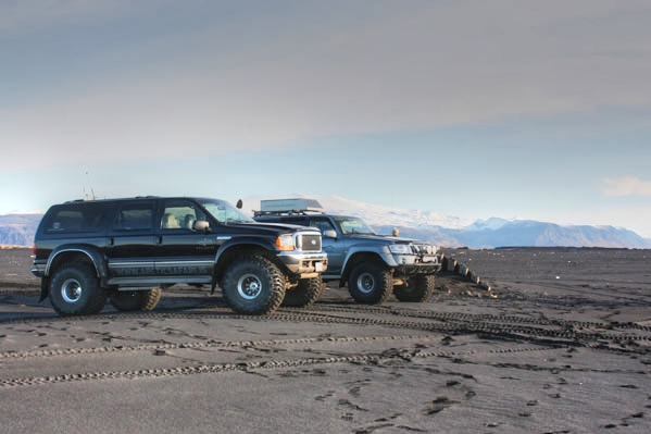 Super jeeps on black sand beach in Southern Iceland