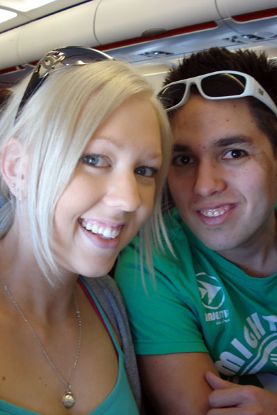 Amy and Kieron on-board a plane