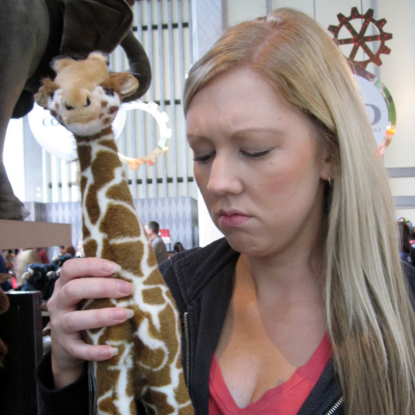 Sad Amy with a Toy Giraffe