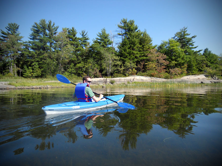Kieran kayaking on one of our epic trips up river in the Canadian wilderness