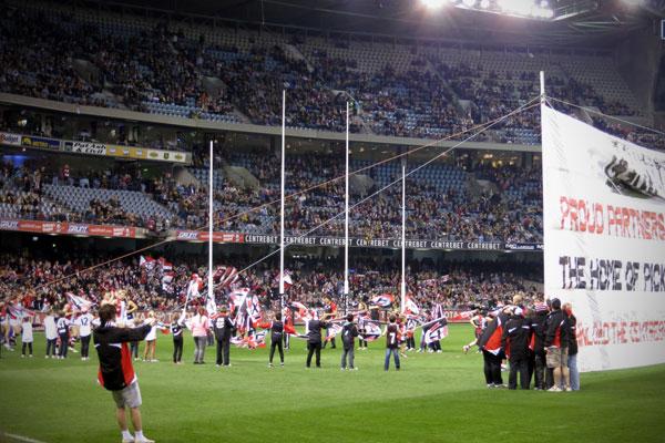St Kilda running through the banner