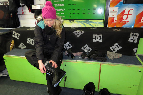 Amy putting on her snow boots