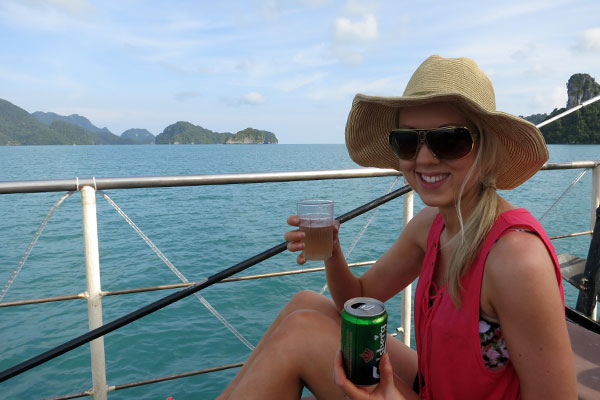 Amy enjoying the complimentary beverages on board